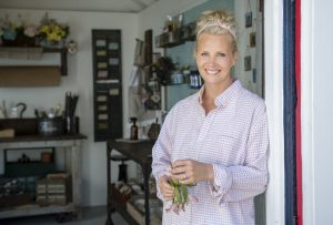 Monica Potter poses for a portrait in the doorway of the new garage as seen on Welcome Back Potter.